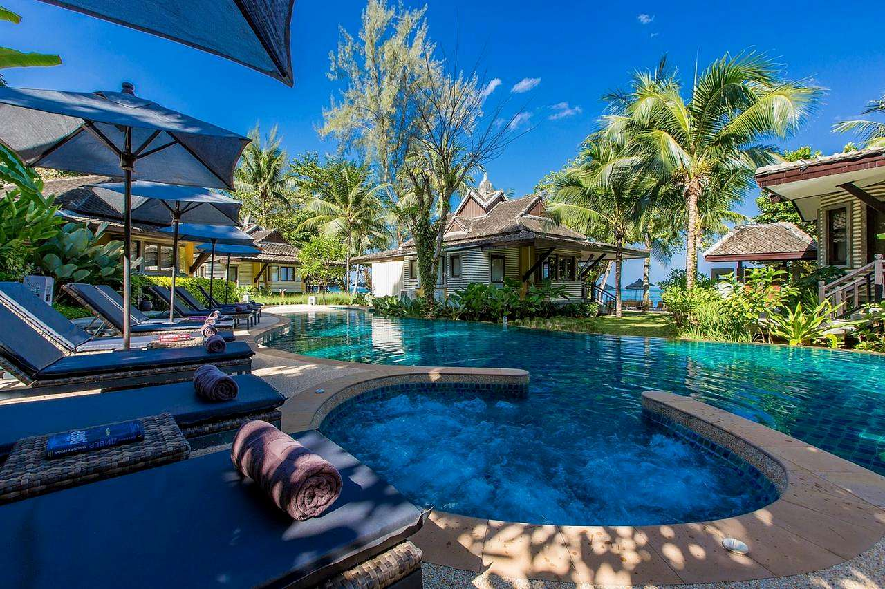 swimming pool with sun beds, Moracea by Khao Lak Resort