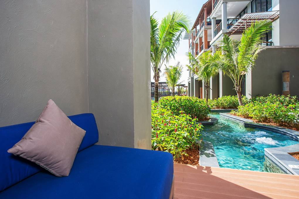 Lounge sofa on the private terrace with access to the swimming pool at Mai Khaolak Beach Resort & Spa