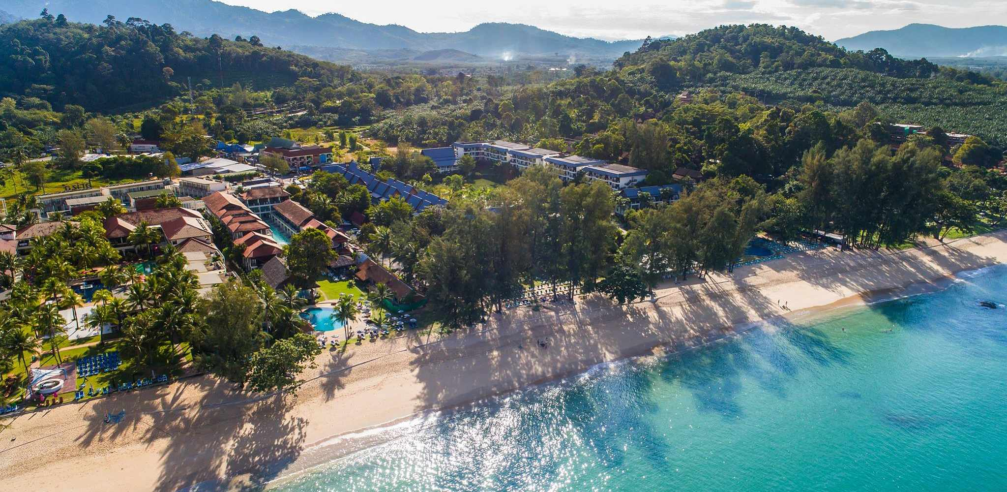 overview photo of the beach, sea and the Emerald Beach Resort in Khao Lak