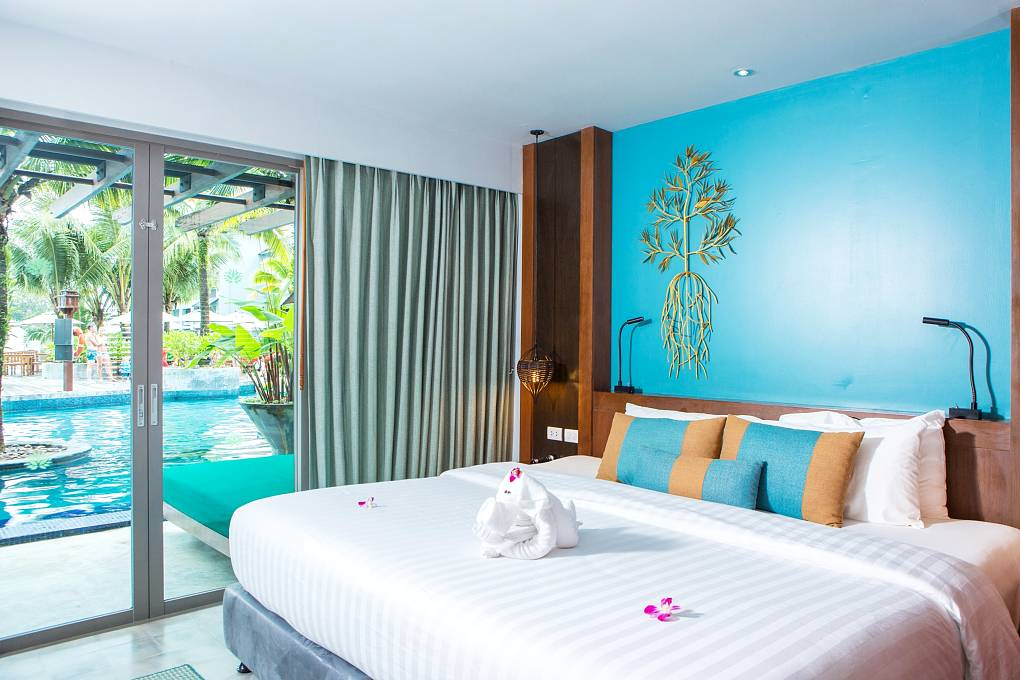 Mai Khaolak Beach Resort & Spa Room with large double bed and direct access to the resort pool