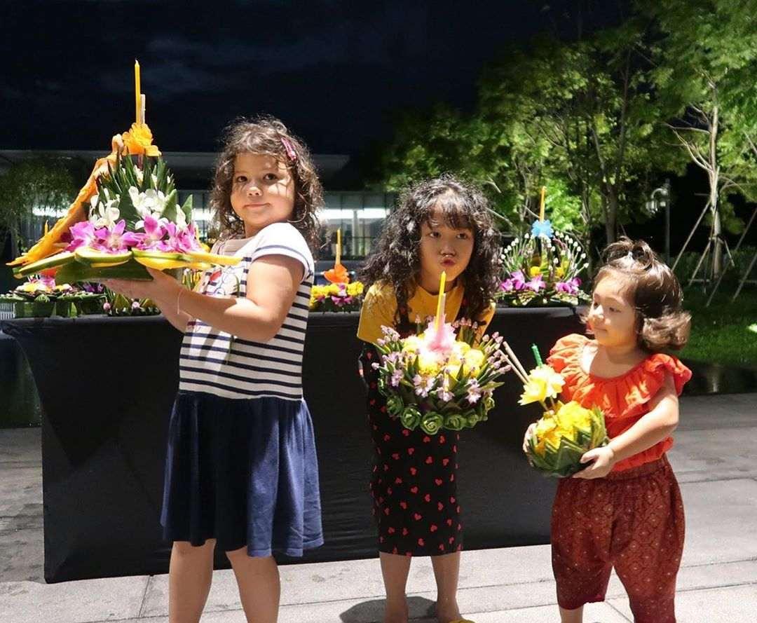 Young children with krathong in her hands during Loy Krathong 2020 in Thailand