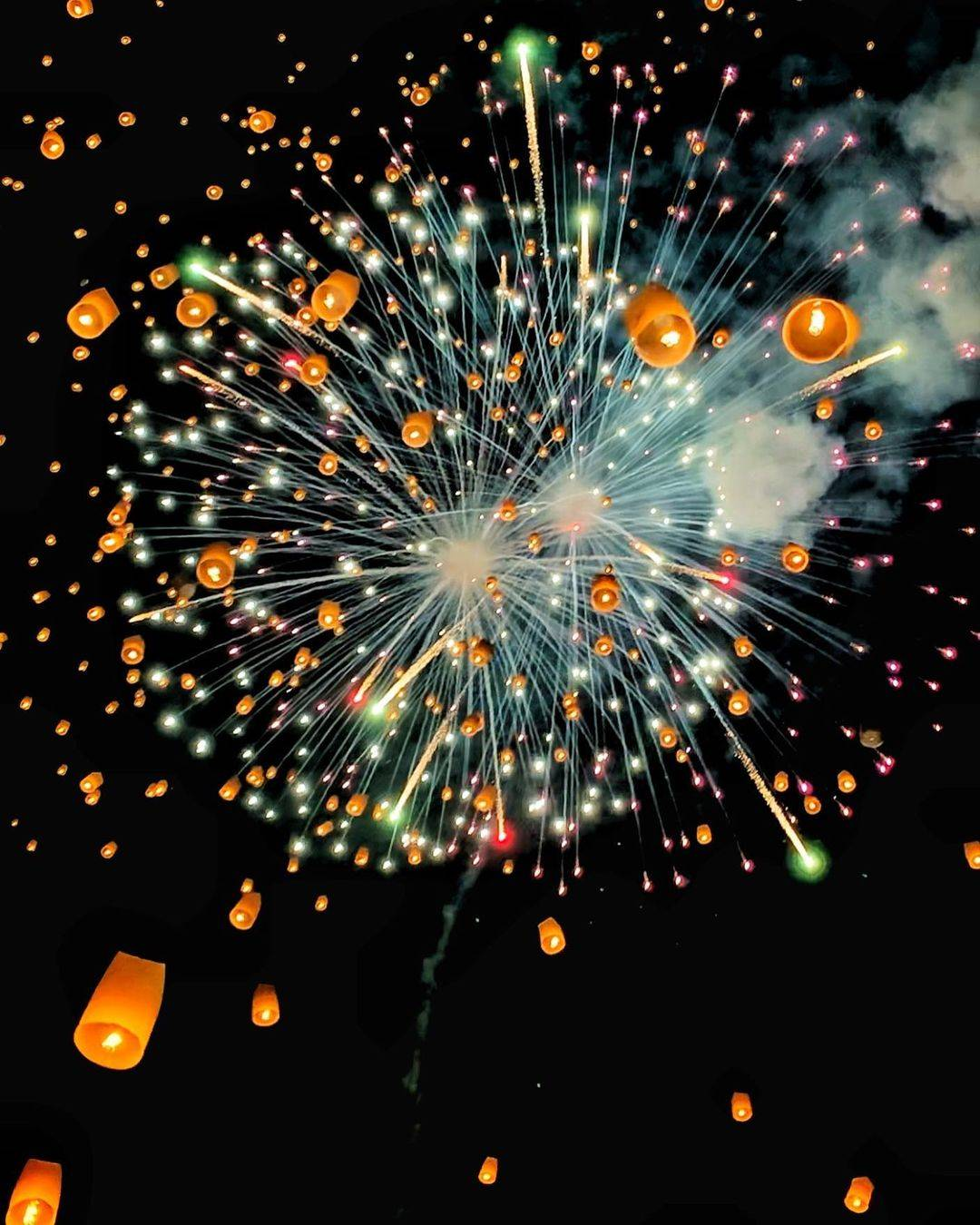 Fireworks and burning lanterns during Yee Peng Festival 2020 in Chiang Mai, Thailand