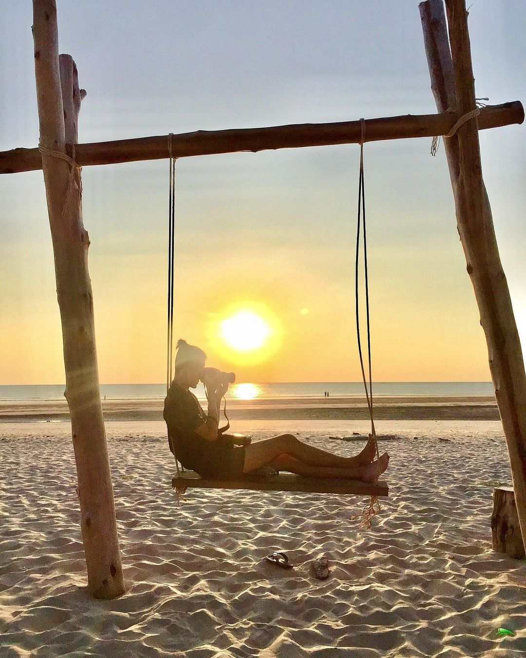On a swing in the sun at Bang Niang Beach in Khao Lak