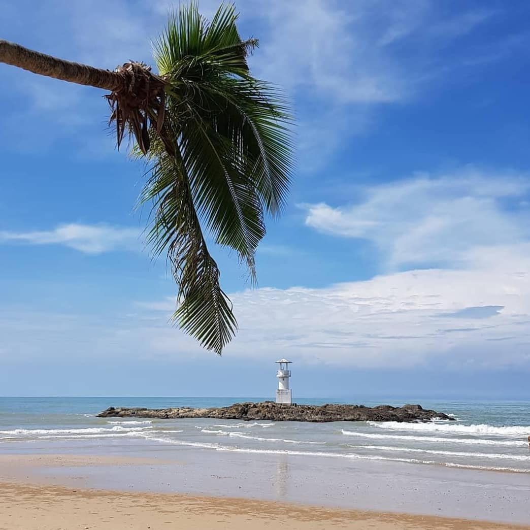 Nang Thong Beach in Khao Lak with lighthouse in the sea