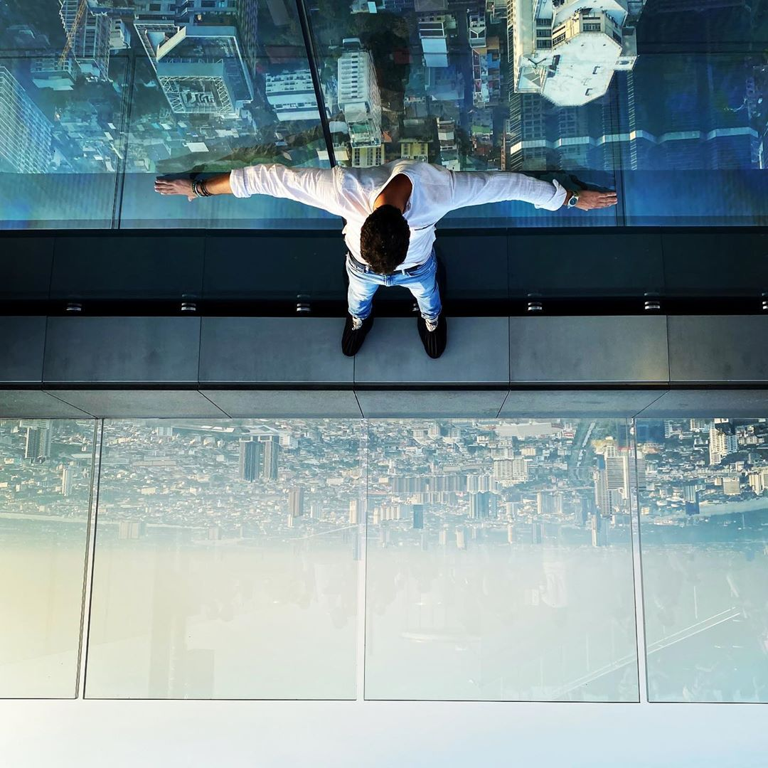 World upside down on King Power MahaNakhon's SkyWalk in Bangkok