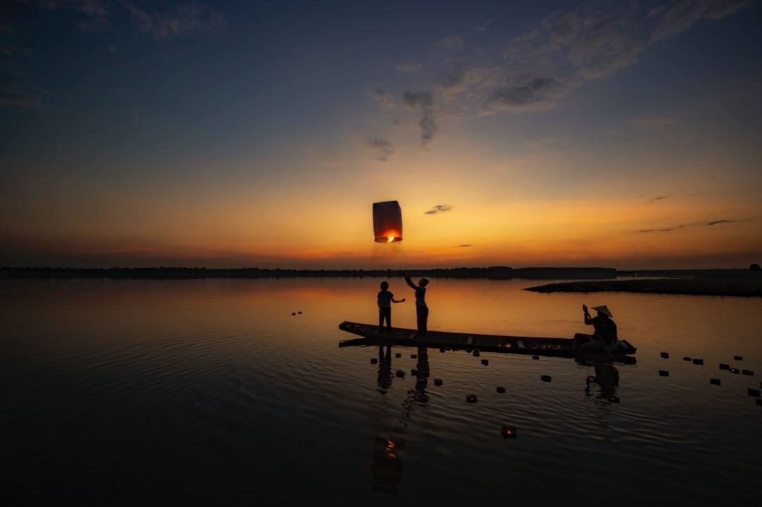 Burning lantern released from a boat during Loy Krathong 2020
