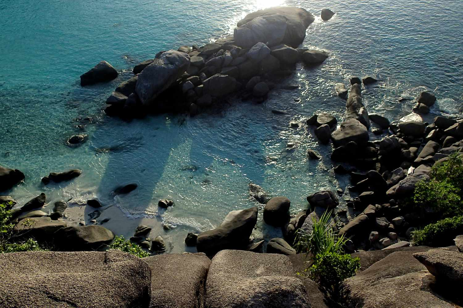 Rocks in the clear water during sunset