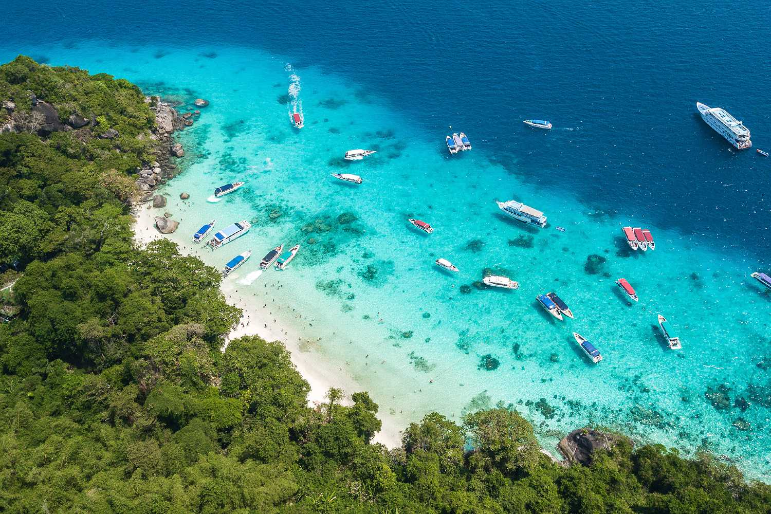 Busy with boats and people at the Similan Islands