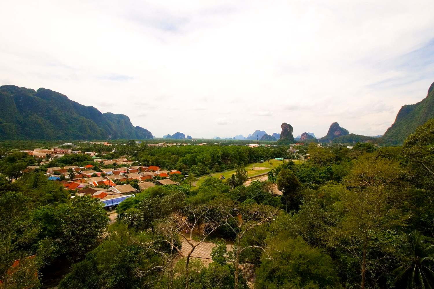 Phang Nga Town sandwiched between rocks seen from above.