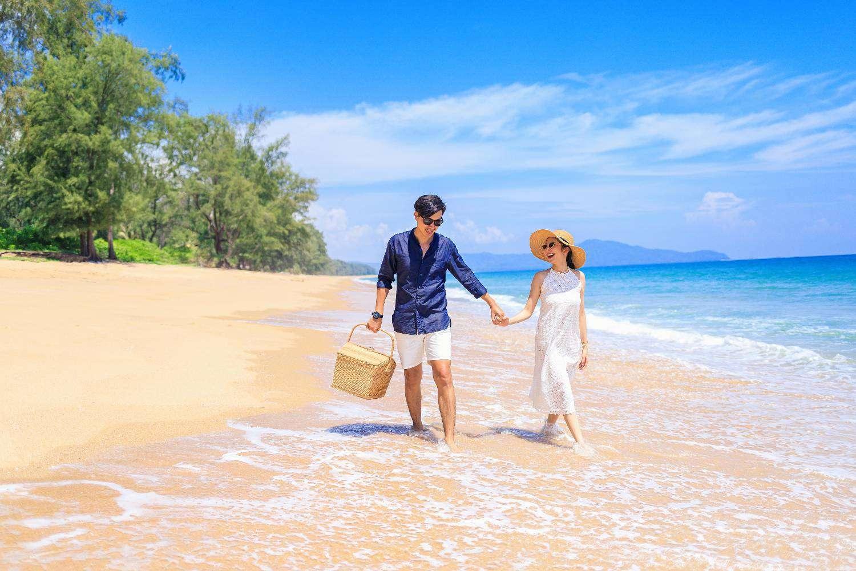 Beach walk  on Mai Khao Beach, Phuket