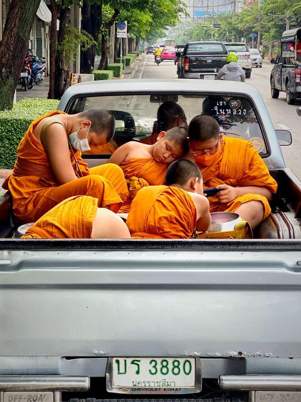sleeping monks in a pickup truck in Bangkok