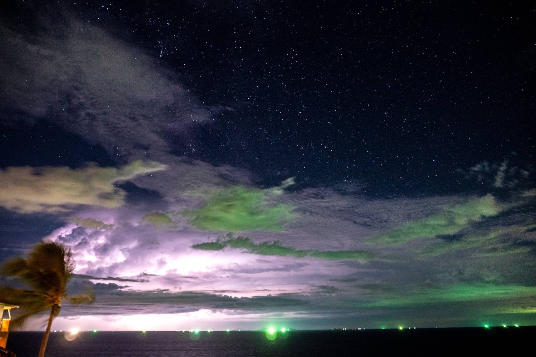 Green lights on fishing boats off Koh Tao coast in Thailand