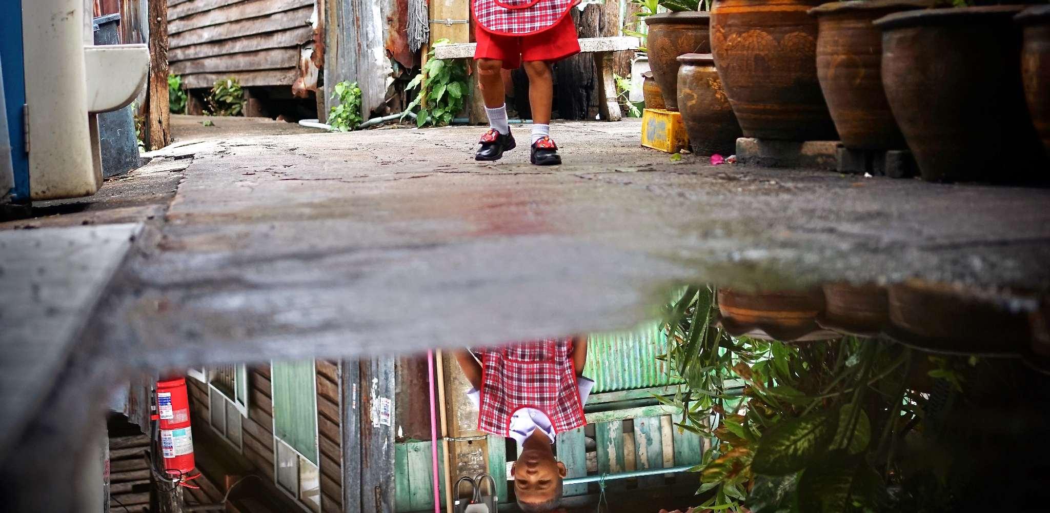 young child at Wat Sawetachat temple in Bangkok, Thailand
