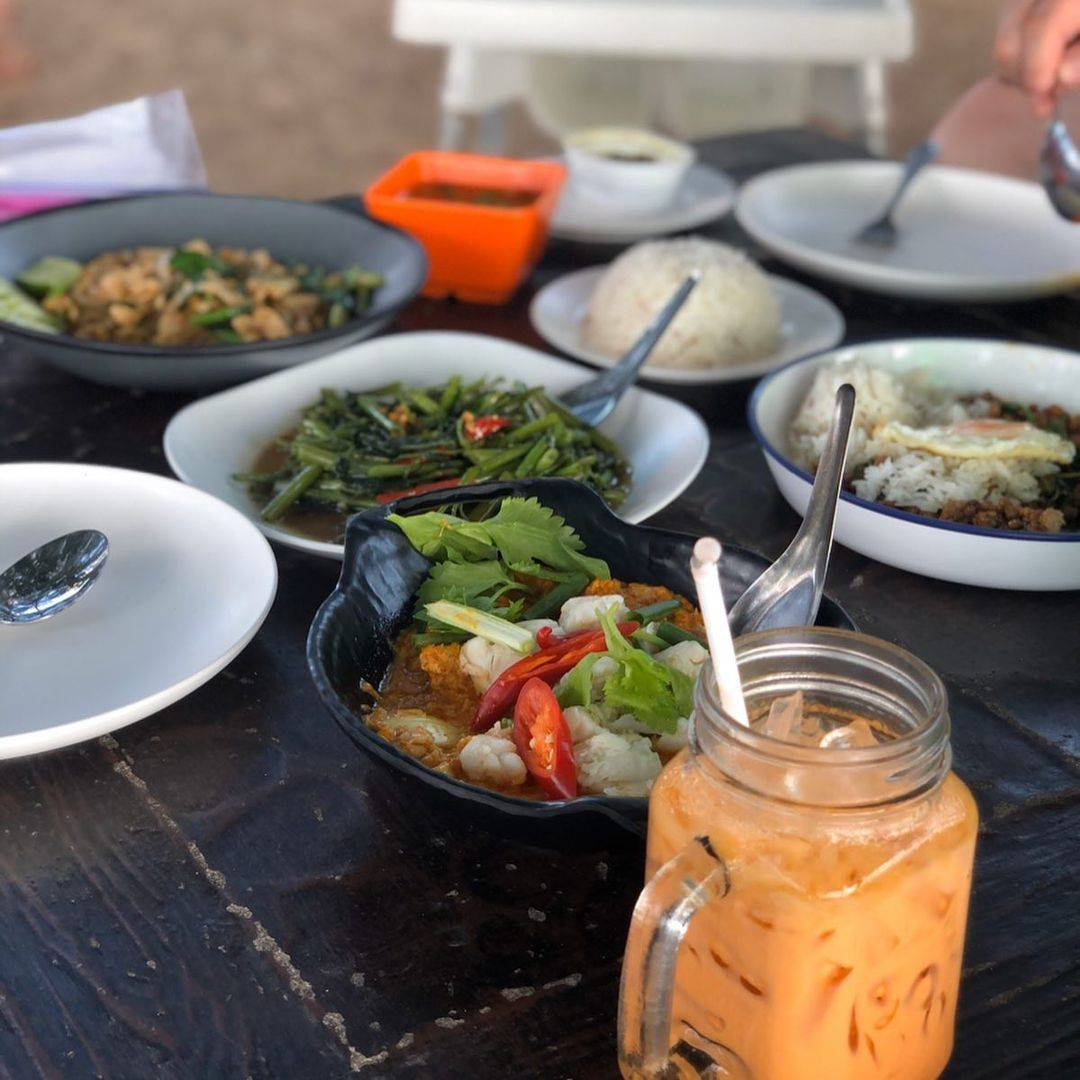 Eating and drinking at Thanoon Seafood in the Phang Nga side of the Sarasin Bridge