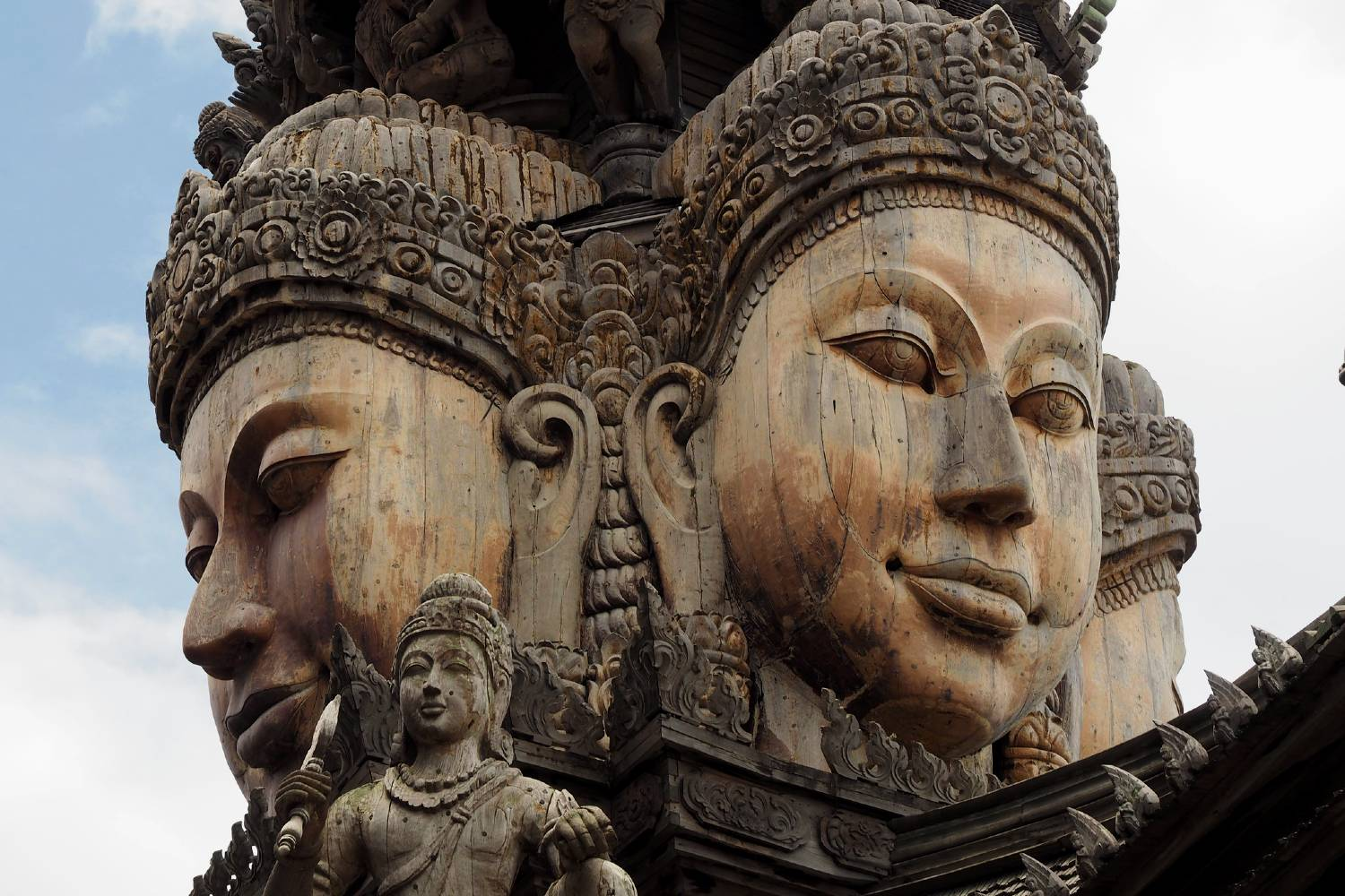large wooden Buddha statues on the roof of The Sanctuary Of Truth Pattaya