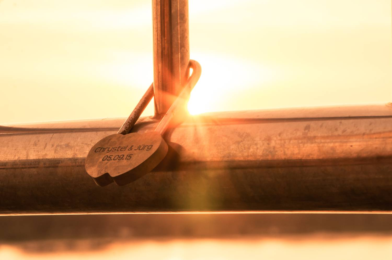 A lock on the Sarasin bridge with sunset in the background