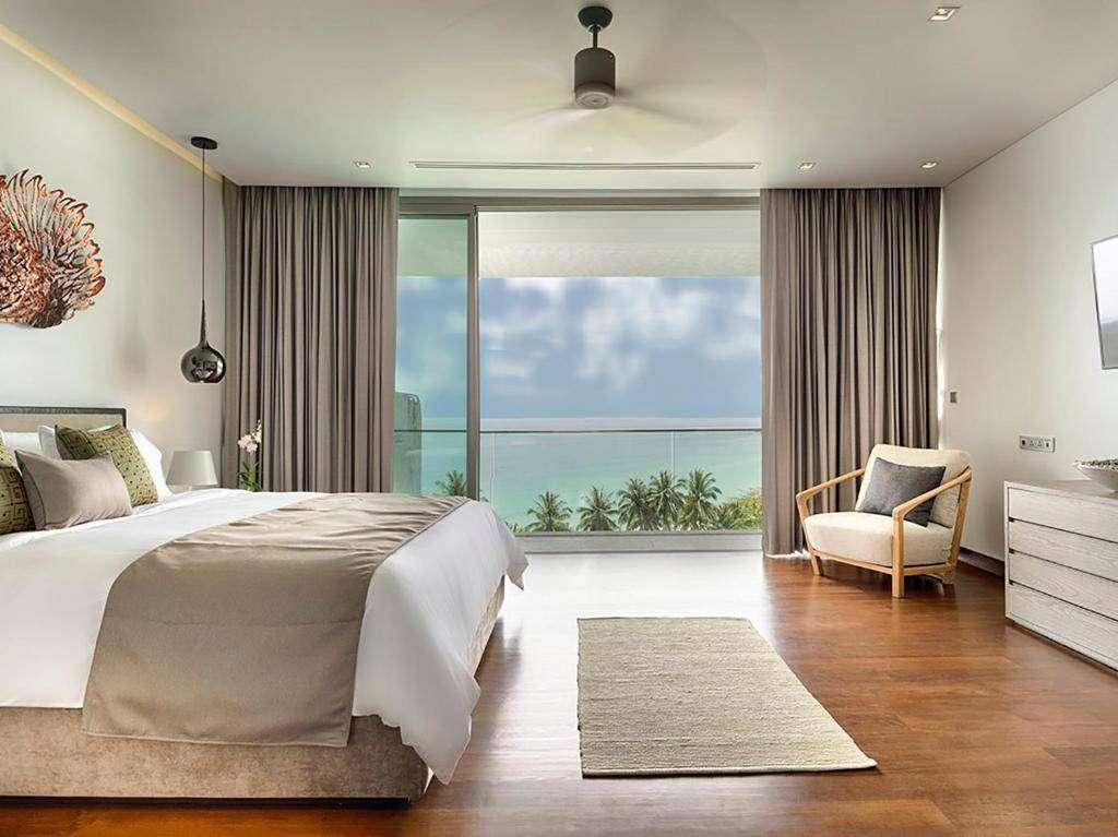 Slaapkamer van Malaiwana Residences aan Nai Thon Beach in Phuket, Thailand