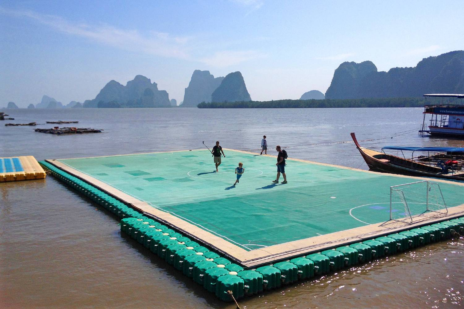 Playing soccer on a floating soccer field of Koh Panyee in the bay of Phang Nga