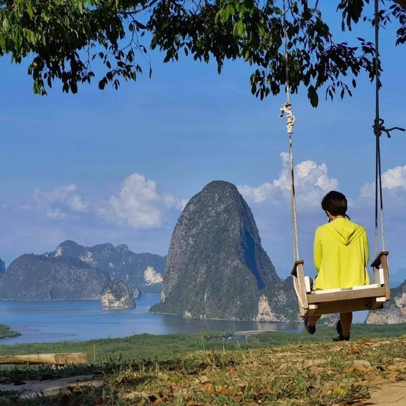 Someone on a swing at the Samet Nangshe Viewpoint in Phang Nga