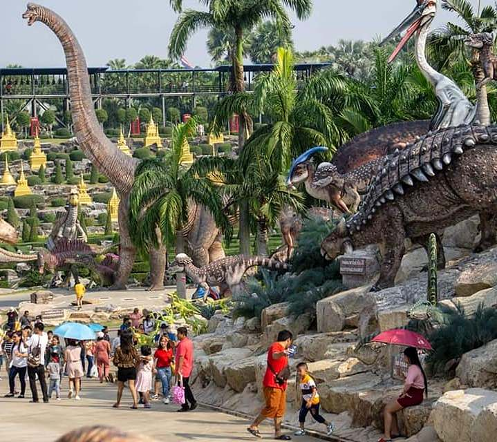 images of life-size dinosaurs among rocks and plants at Nong Nooch Garden in Pattaya