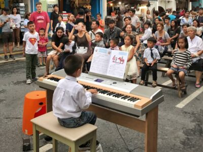 Child Playing Piano On The Sunday Walking Street In Phuket Town