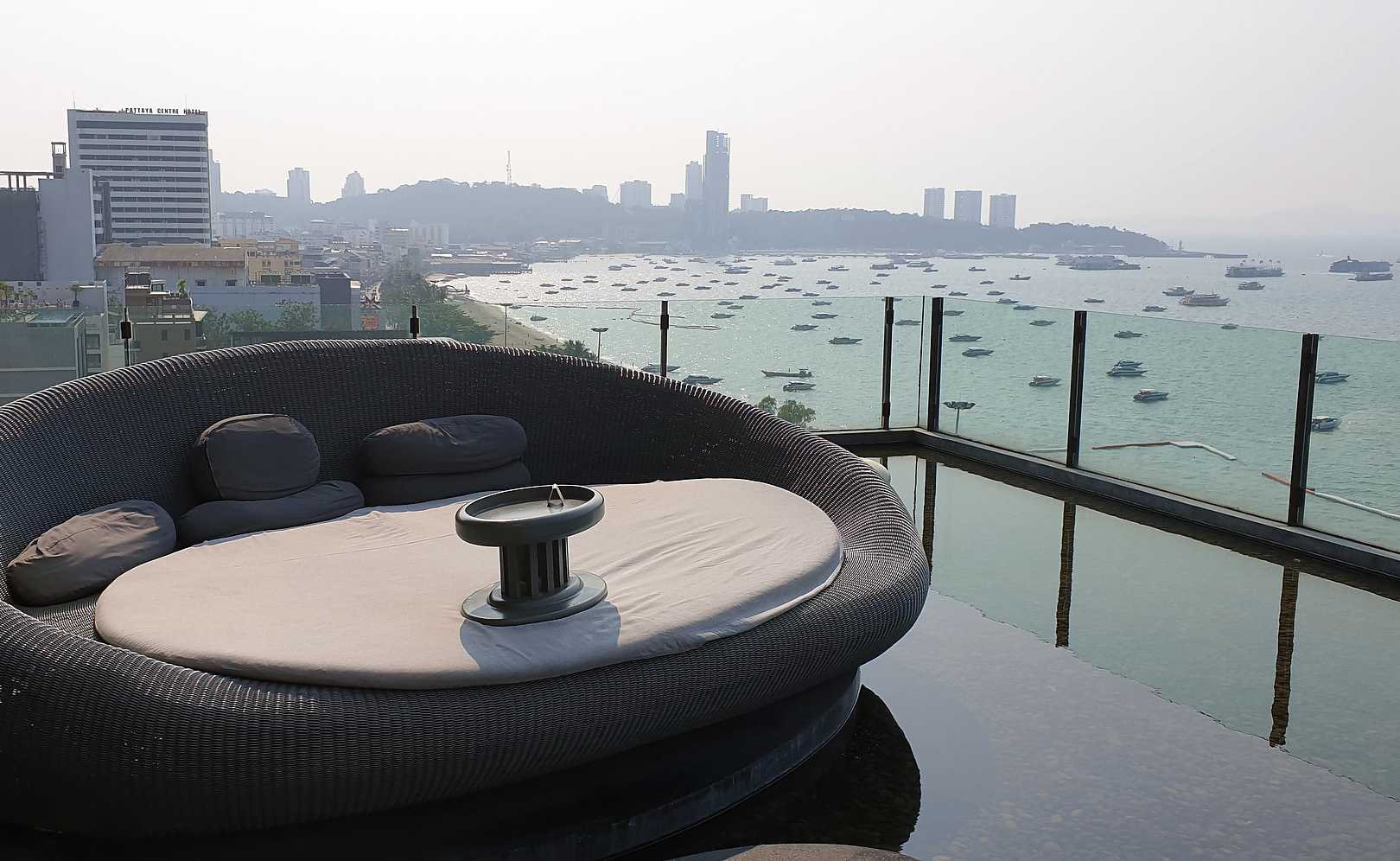 Lounge chair and pool on the roof of the Hilton Hotel in Pattaya