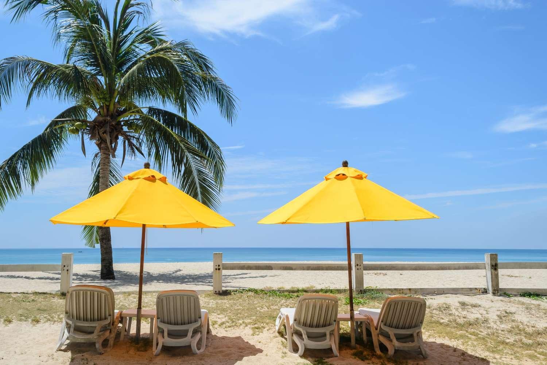 Beach chairs with umbrellas at Bang Tao Beach on Phuket