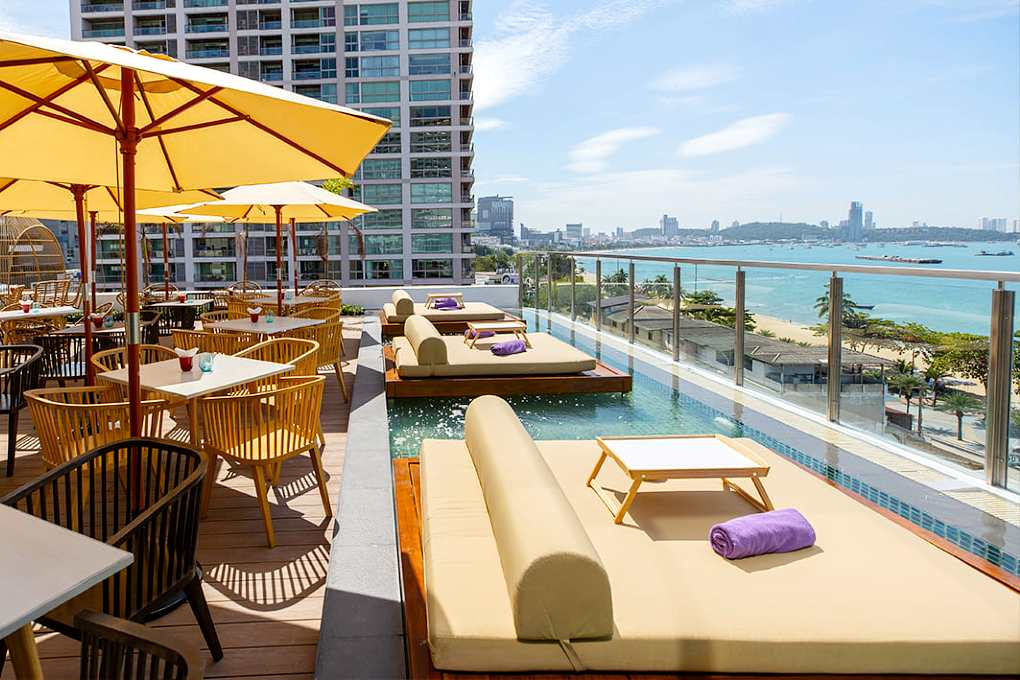 Two person lounge sofas in the water overlooking the sea at Virgin rooftop Pattaya