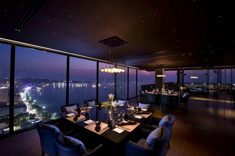 Hilton Restaurant, beautifully set table with large windows overlooking the sea of Pattaya
