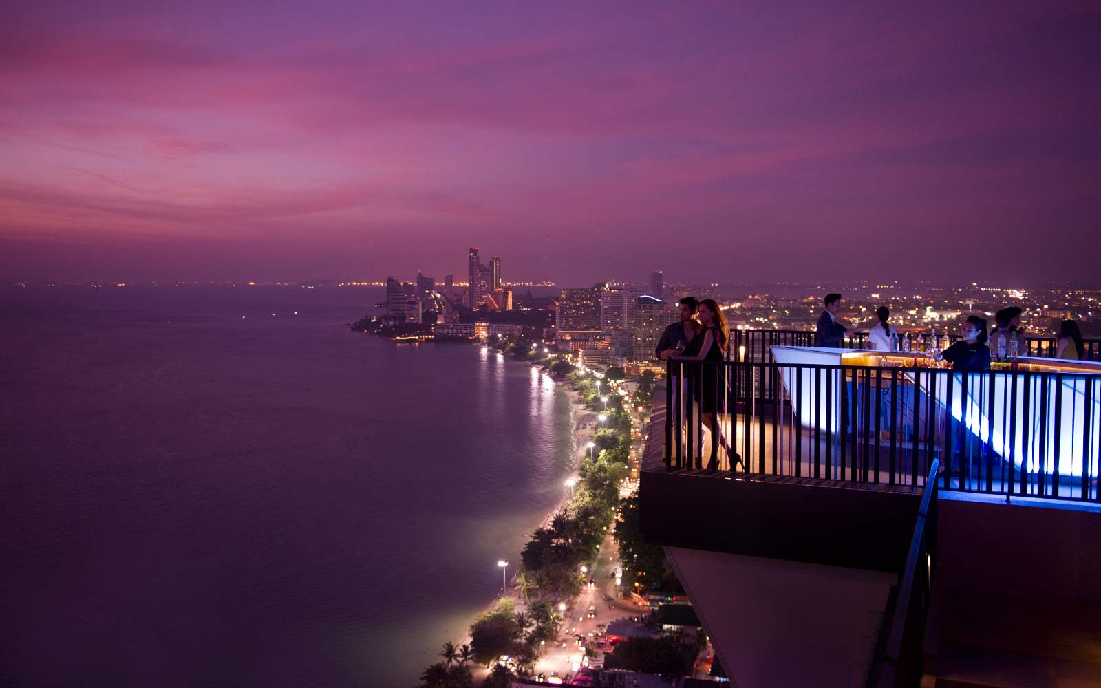 Horizon Rooftop bar at Hilton, two people enjoy the view over Pattaya