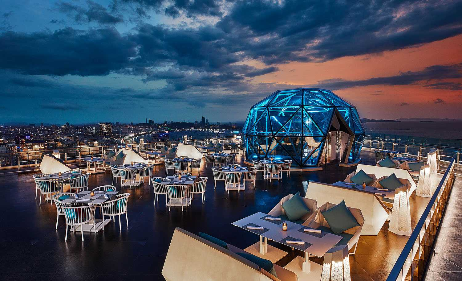 Sky Bar with glass dome and magical view of Pattaya during sunset at The Sky 32 Pattaya