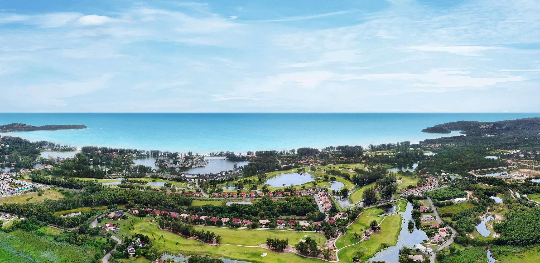 The bay of Bang Tao Beach on Phuket and Laguna Phuket seen from the air