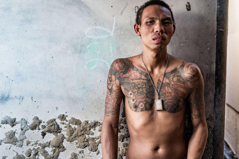 Thaise man met tatoeages