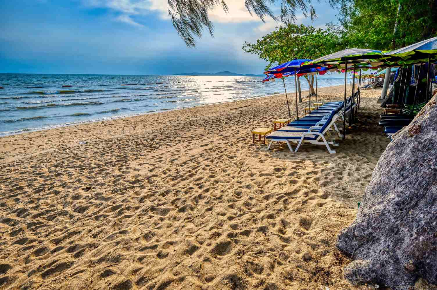 Dongtan Beach Pattaya sunbeds in the sand during sunset