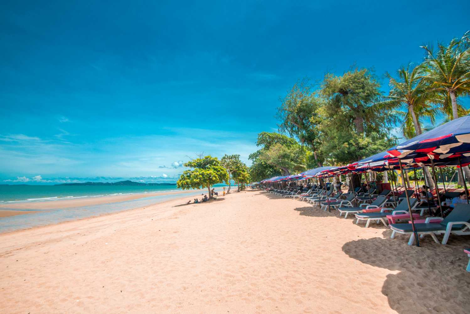 beach with beach beds on a sunny day in Pattaya