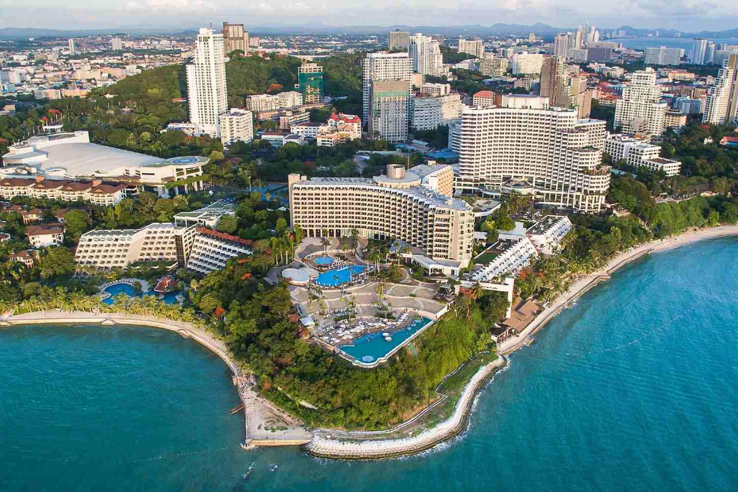 resort with pool at the beach and sea view in Pattaya