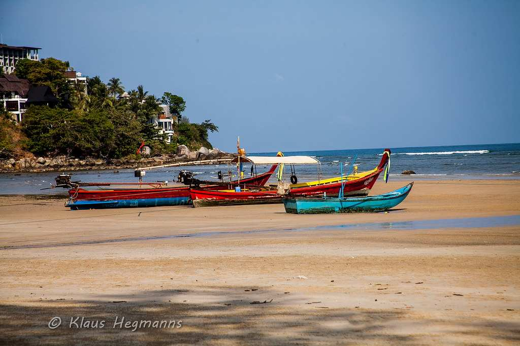Longtail boat docked in the northern part of Kamala Beach on Phuket