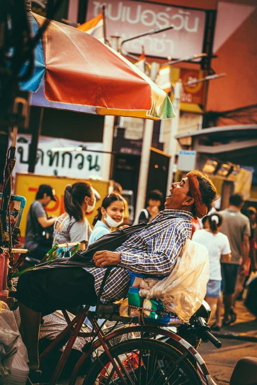 Street food salesman on a bike in Bangkok