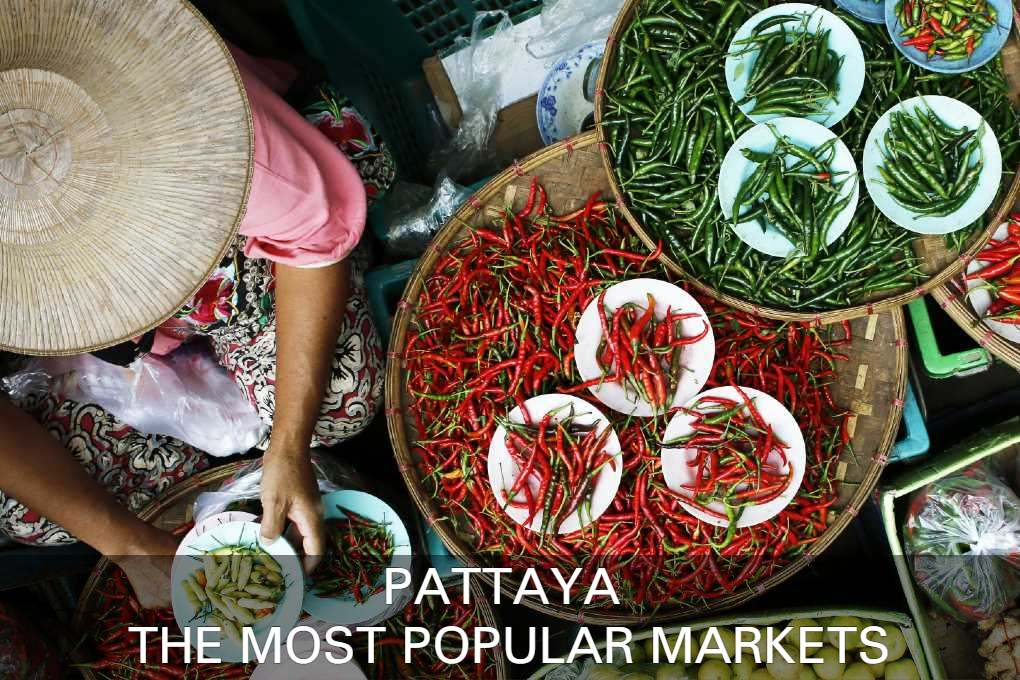 Market in Pattaya, woman sells red and green peppers at floating market