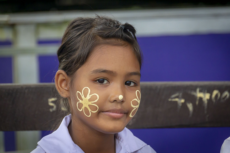 A Mon flower girl on the bridge in Sangkhlaburi, Thailand