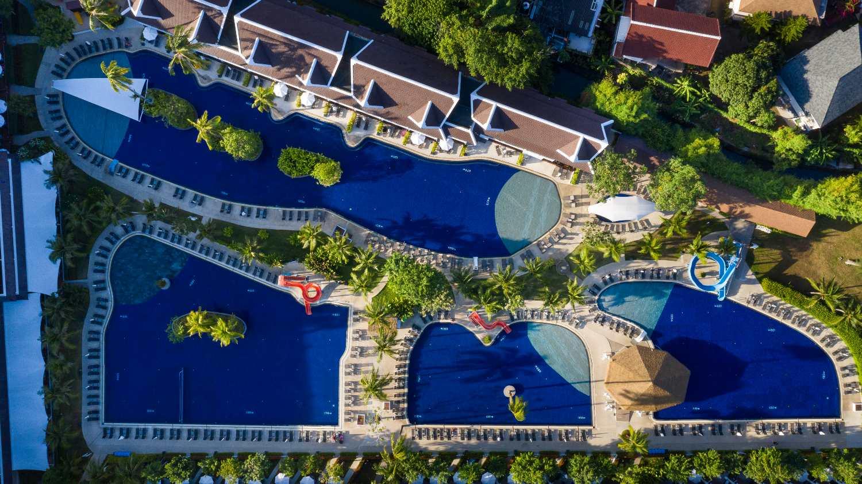 Aerial view showing four pools of the Sunwing Kamala Beach on Phuket