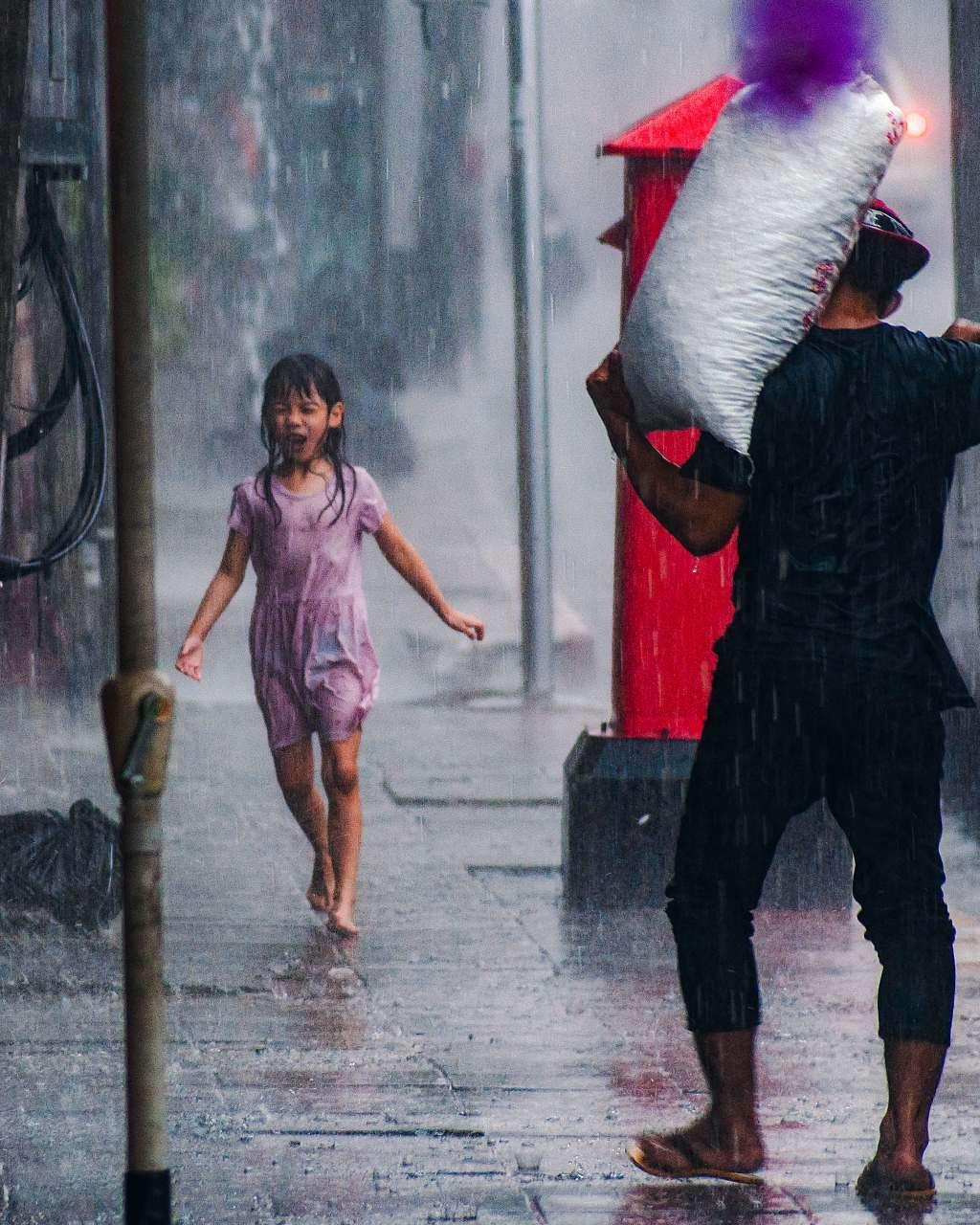 Little girl dancing in the rain